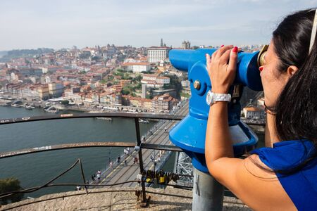 Vila Nova de Gaia,, Portugal - September 16, 2018 : Woman in the viewpoint of the Serra do Pilar enjoying the magnificent view of the city of Porto, Portugal