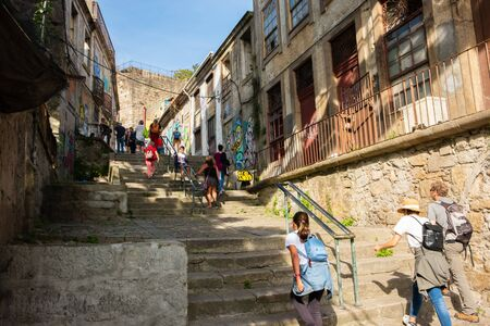Porto, Portugal - September 16, 2018: People ascending the Street Stairs of the Code?al in the city of Porto, Portugal Sajtókép
