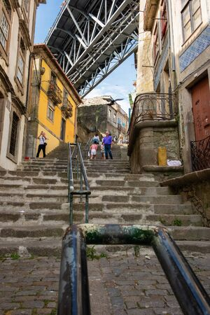Porto, Portugal - September 16, 2018: Stairs of the Code?al, street that passes underneath the bridge Lu?z i in Invicta frequented by many tourists, Porto, Portugal Sajtókép