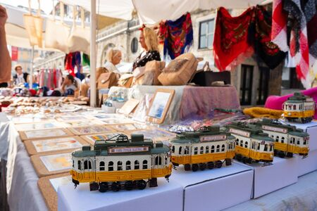 Porto, Portugal - September 16, 2018 : Street vendors in the port city, miniature tram that circulates in the streets of the city Porto, Portugal Sajtókép