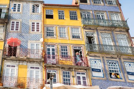 Porto, Portugal - September 16, 2018 : Daily life in the city people the window of the colorful houses of Invicta Porto, Portugal Sajtókép