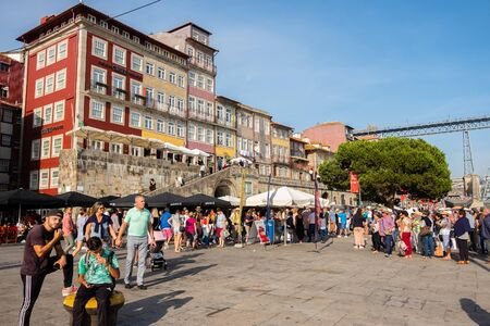 Porto, Portugal - September 16, 2018 : Busy pier of Ribeira with its beautiful architecture near the Luiz I bridge, Portugal