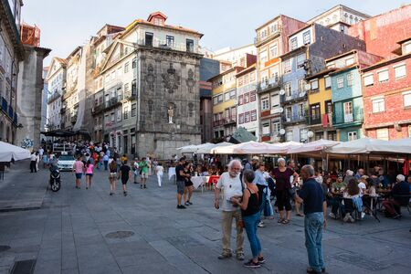 Porto, Portugal - September 16, 2018 : Bustling Ribeira Square on a Sunday afternoon with its beautiful architecture, Porto Portugal