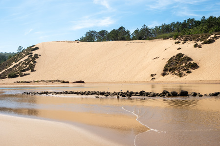S. Martinho do Porto, Portugal - September 21, 2018 : Dunes on the banks of the river Salir do Porto Alcobaca, Portugal