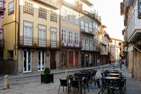 Guimaraes, Portugal - September 26, 2018 : Narrow and typical street of the historic area of the city Guimaraes,Portugal