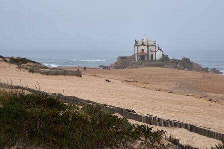 Vila Nova de Gaia, Portugal - September 30, 2018 : Foggy day by the sea next to the chapel Porto district, Portugal Sajtókép