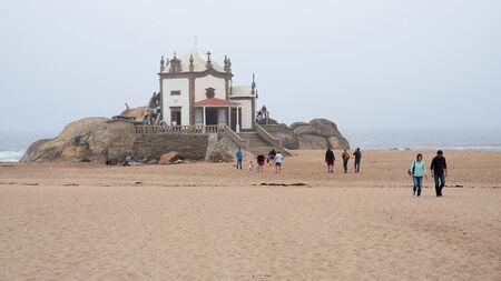 Vila Nova de Gaia, Portugal - September 30, 2018 : Pilgrims visit the chapel on foggy days by the sea Porto district, Portugal Sajtókép