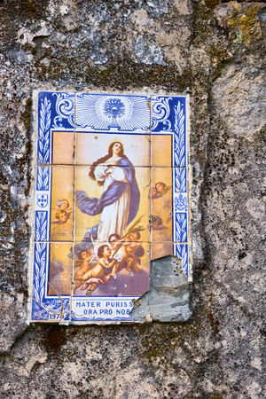 Ancient ceramic tile on a portuguese wall