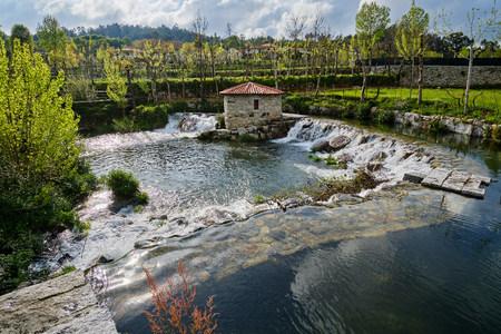 Fafe, Portugal - April 14, 2019 : Water mill on the banks of the Vizela river, Braga district, Portugal Standard-Bild