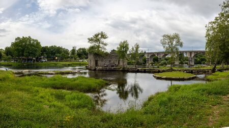 Amares, Portugal - June 20, 2019: Ruins of a mill on the green banks of the river C?vado in Braga, Portugal