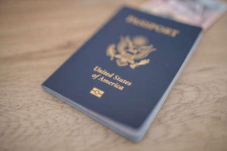 United States of America Passport with a Five Honduran Lempiras Bill Inside