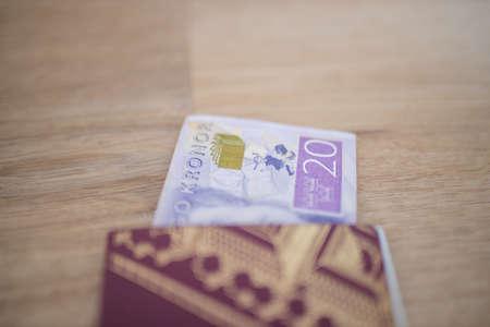 20 Swedish Kronor Banknote Partially Inside a Sweden Passport Foto de archivo