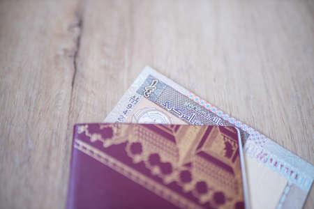 Kuwait Quarter Dinar Bill Partially Inside a Sweden Passport