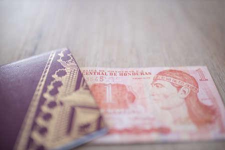 Swedish Passport and a One Honduran Lempira Bill on a Wooden Table 免版税图像