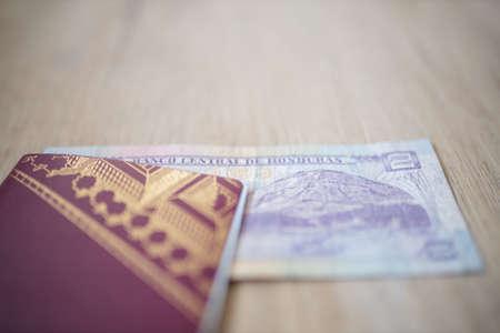 Central Bank of Honduras on a Two Lempiras Bill Inside a Swedish Passport 免版税图像
