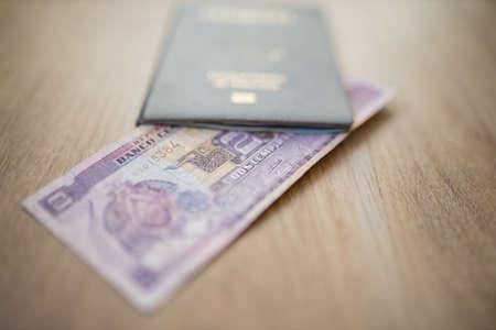 Central Bank of Honduras on a Two Lempiras Bill Inside an American Passport