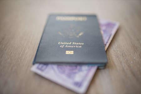 United States of America Passport with a Two Honduran Lempiras Bill Inside it Foto de archivo