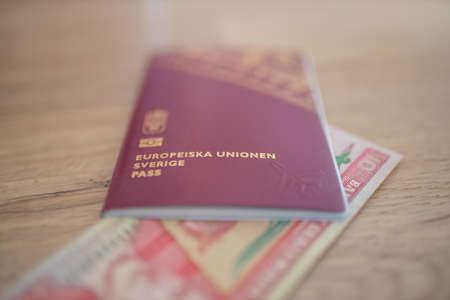 European Union, Sweden Passport with a Ten Quetzales Bill Inside 免版税图像