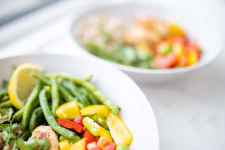 Meat and buckwheat dishes with green beans and tomato Stock Photo