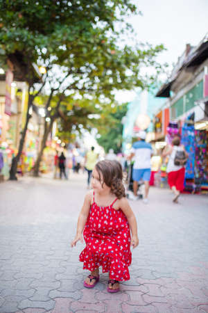 Adorable and vibrant little girl playing in an alley