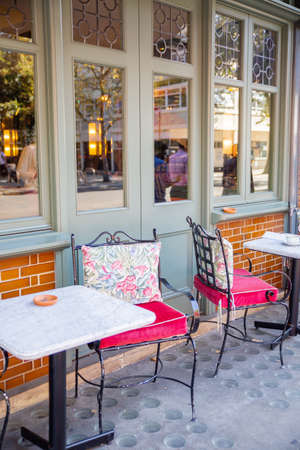 Comfy metal chairs and tables outside a British restaurant