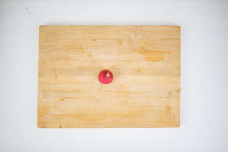 Fresh radish isolated on a cutting board from above 写真素材