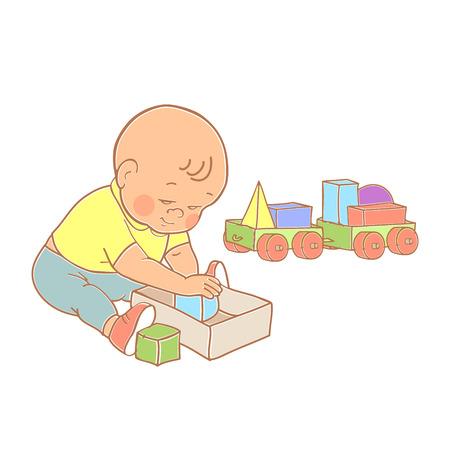 Peu beau bébé garçon jouant avec des jouets. Kid joue avec le train de constructeur de formes géométriques. Kid construit maison de cubes.