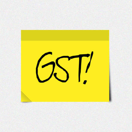 Handwritten Word GST on yellow sticky note reminder