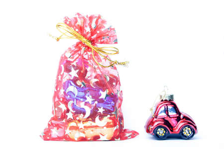 starlike: xmas bag and toy car isoalted on white Stock Photo