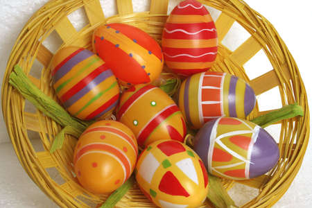 eastertime: colorful painted easter eggs in a basket Stock Photo
