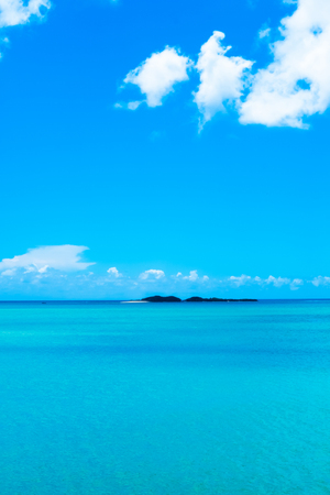 Kojima floating in the sparkling sea in Okinawa of emerald green