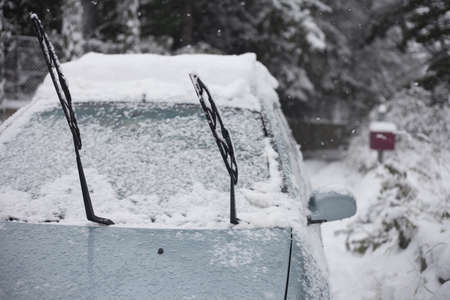 a car is covered by snow Stock Photo