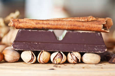 chocolate and nuts - Focus on pistachio nut Stock Photo