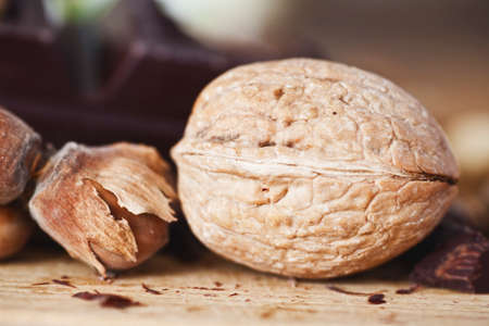 a walnut and a hazelnut on wooden table Stock Photo