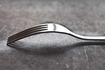 a fork on a blackboard