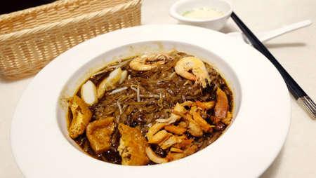 laksa: Singapore Laksa noodles on white dish