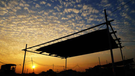 cloudscape: cloudscape and village at sunset Stock Photo