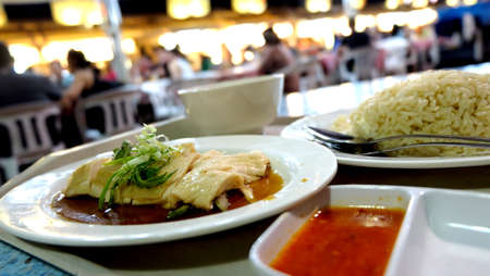 malaysia culture: Singapore night food market Hainan chicken rice Stock Photo