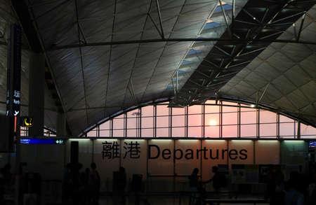 departures: Hong Kong Airport Departures and romantic sun Stock Photo