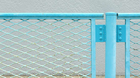 chainlink fence: Blue metal chainlink fence in the street
