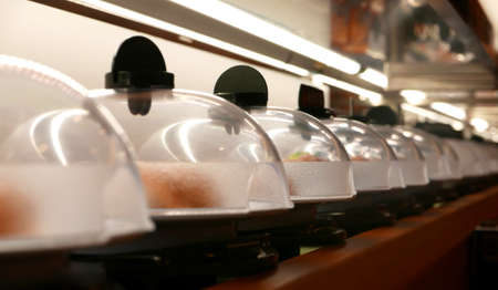 conveyer: Sushi and sashimi conveyer in Japanese restaurant Stock Photo
