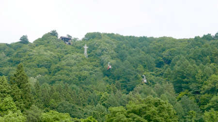 hill station tree: Cablecar station and cable cars in one of Japan mountains Stock Photo