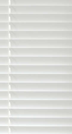 lifted: Vertical white venetian blind lifted