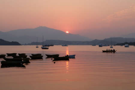 recreational: recreational boats on the lake at sunset