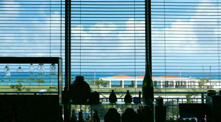 common room: The shadow of venetian blind lifted and blue sky