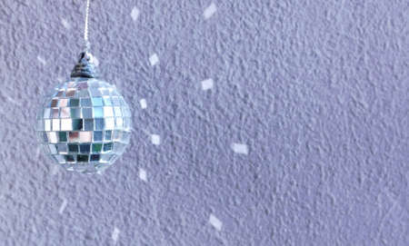 disco mirrorball: small decoration disco ball with reflection on the wall Stock Photo