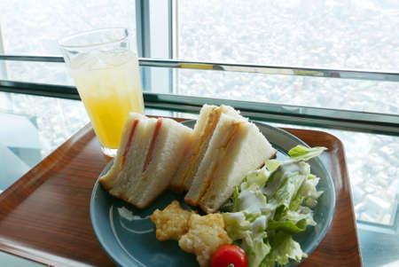 sandwish: sandwishes, salad and pineapple juice breakfast set
