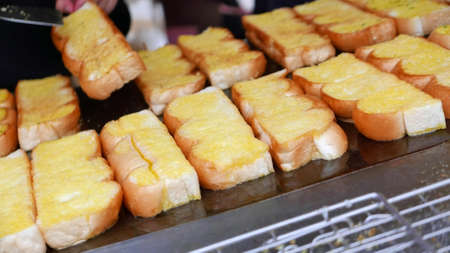 bread shop: Barbeque outdoor butter garlic bread shop in Thailand