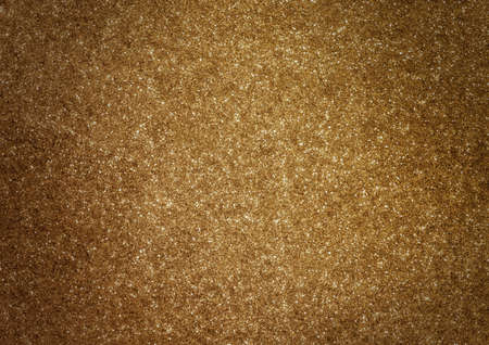 gold textured background: The sparkle bright glittering golden abstract background