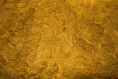 aluminium wallpaper: The golden metallic shinny textured background with detail pattern Stock Photo